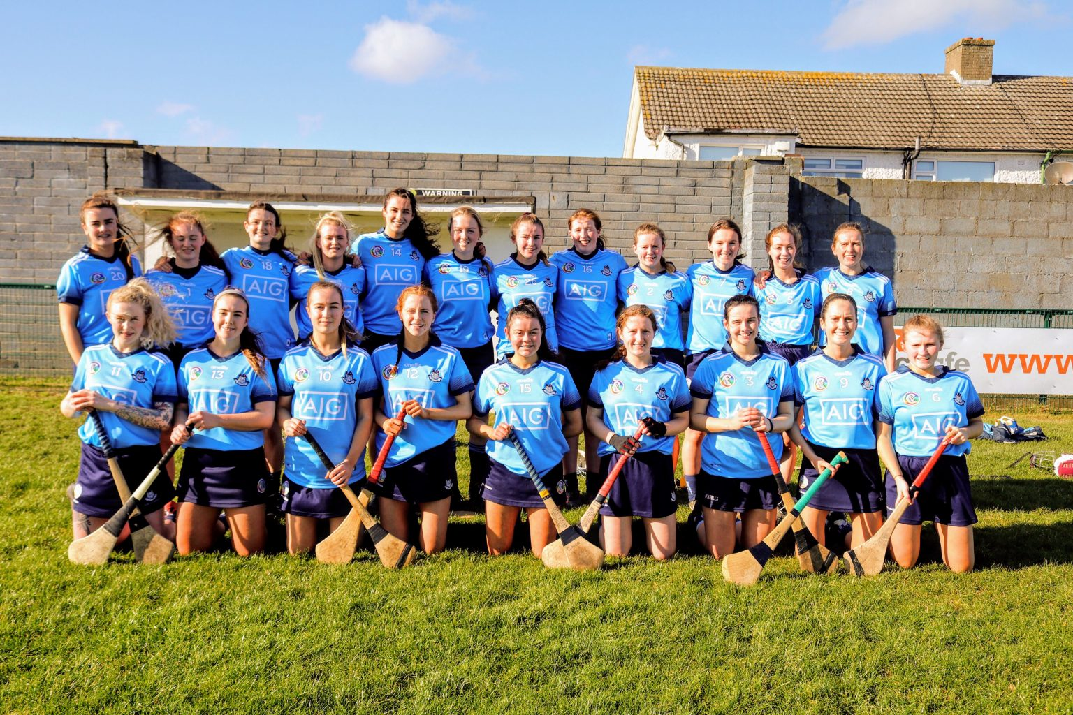 Dublin Intermediate Camogie Team in sky blue jerseys and navy skorts pose for team photo