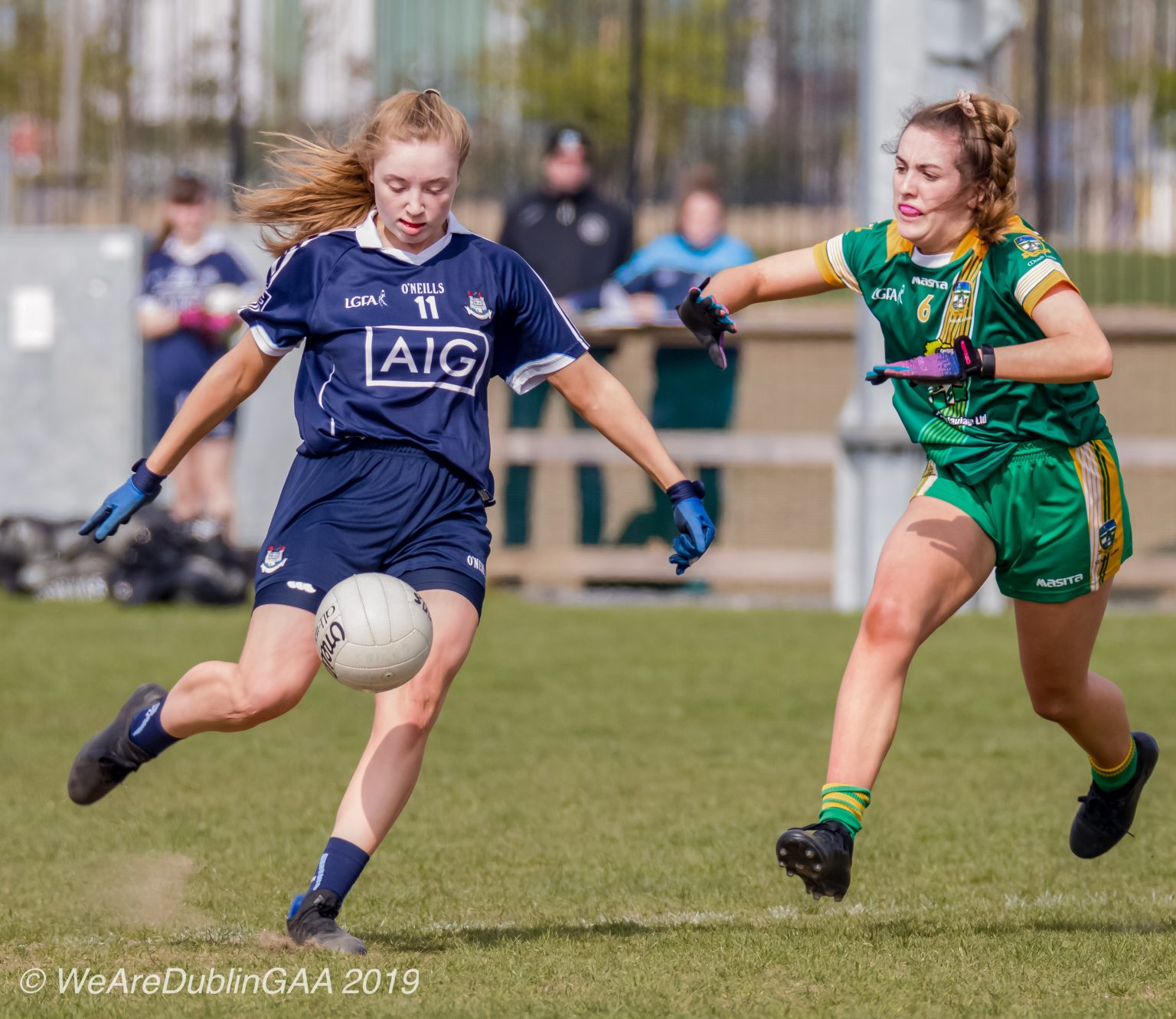Dublin Ladies Footballer in a Navy Jersey and navy shorts kicks the ball at goal, Dublin have qualified for the Lidl NFL Semi Finals