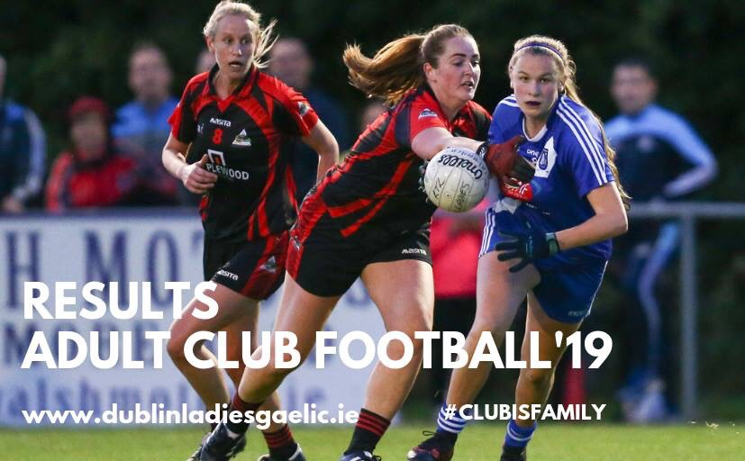 Two ladies Footballers one in a blue jersey and blue shorts and the other in black jersey and black shorts with red sleeves and red stripes down the front battle for the ball during the Dublin LGFA Adult Football League