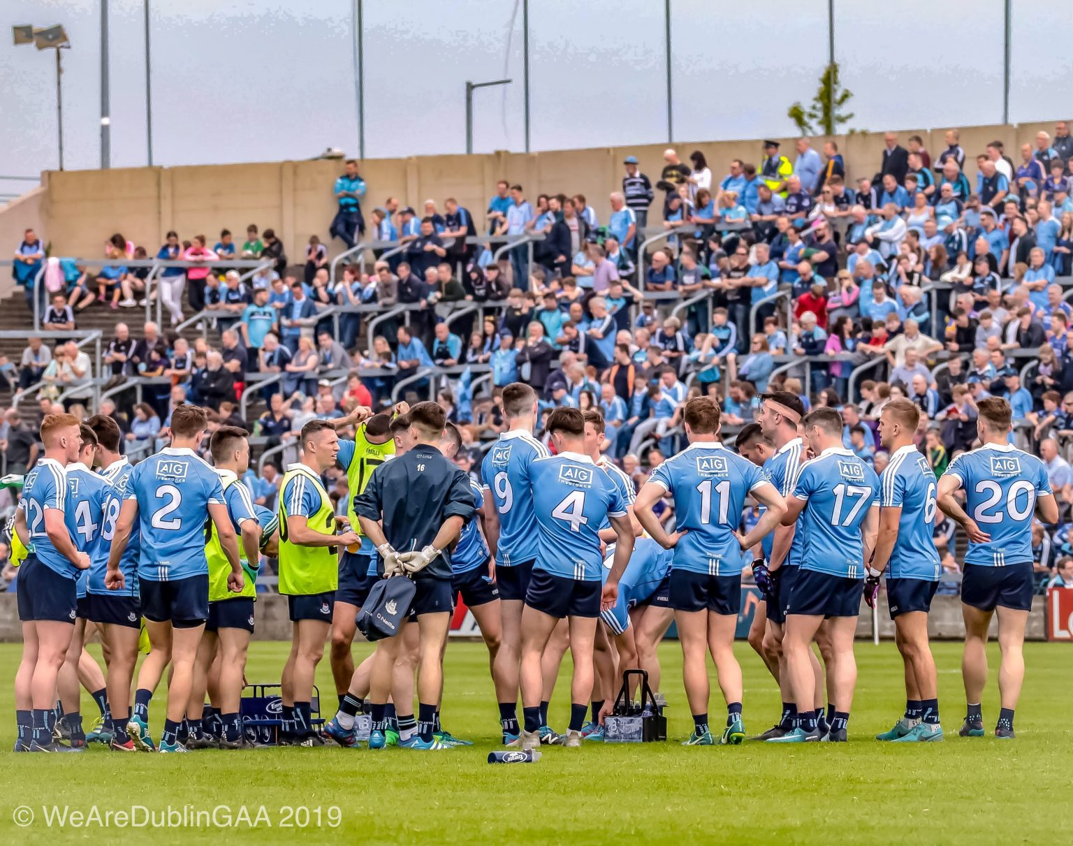 Dublin Men's Football team gather in a huddle on the pitch before a game