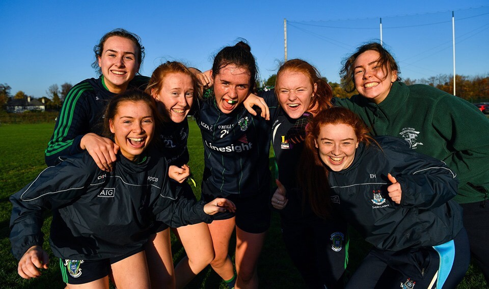 Members of the Foxrock Cabinteely Ladies Football team celebrating on the pitch they have qualified for the championship semi finals after last night's club championship results