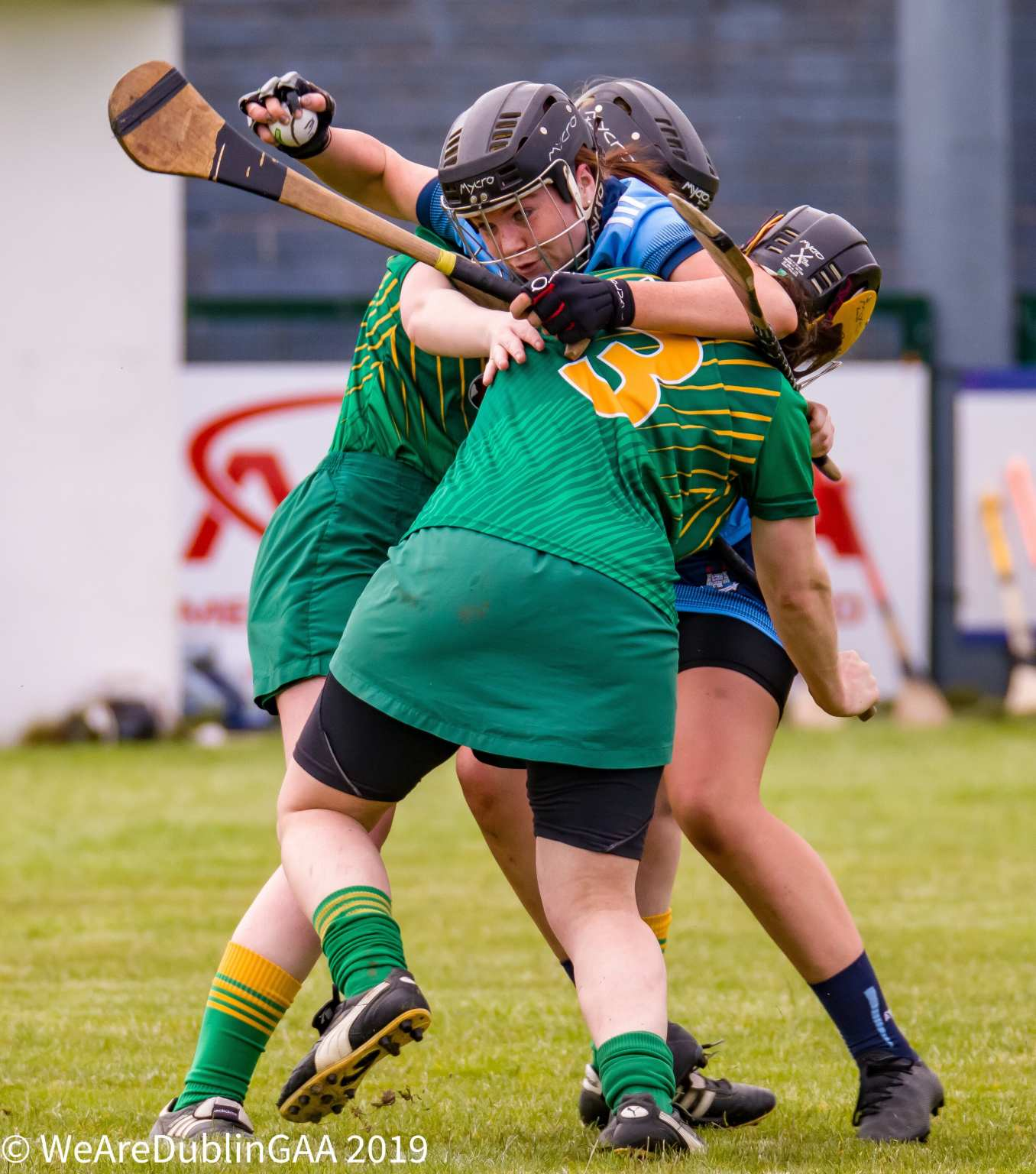 Dublin Camogie player tries to get past the attention of two Meath players, the All Ireland Intermediate Championship starts this weekend.