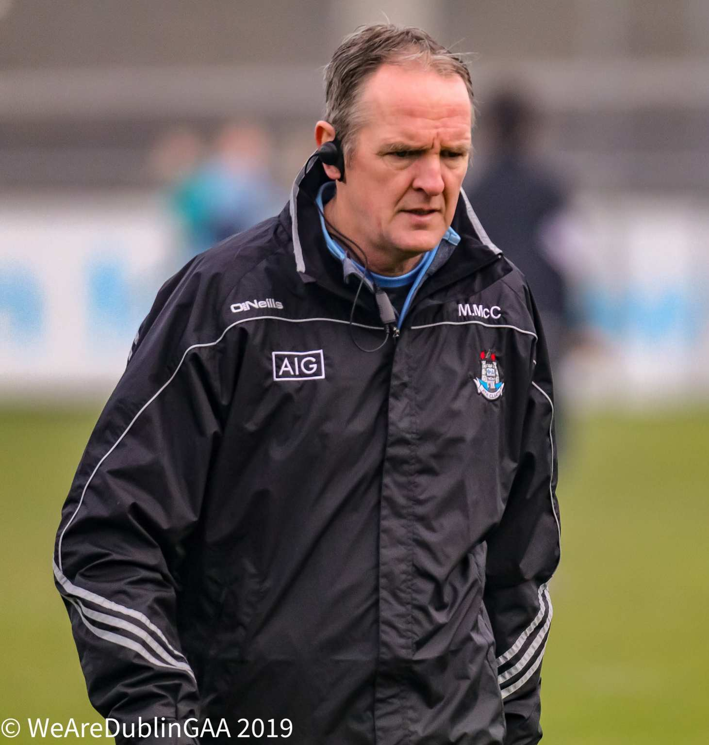 Dublin Hurling Manager Mattie Kenny In a black rain jacket with Dublin crest.