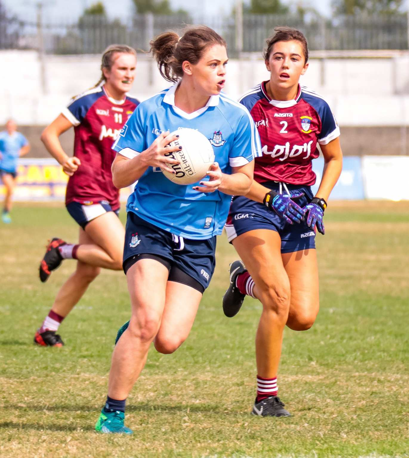 Dublin Ladies footballer break away with the ball from a Westmeath player during the Leinster Final, the LGFA Have confirmed there will be Live Coverage of this year's final streamed on Facebook.