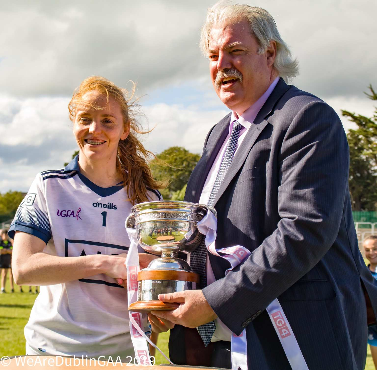 Dublin's Ciara Trant is Presented with the Leinster Trophy as Dublin beat Westmeath to claim their Eighth TG4 Leinster Senior title in a row.