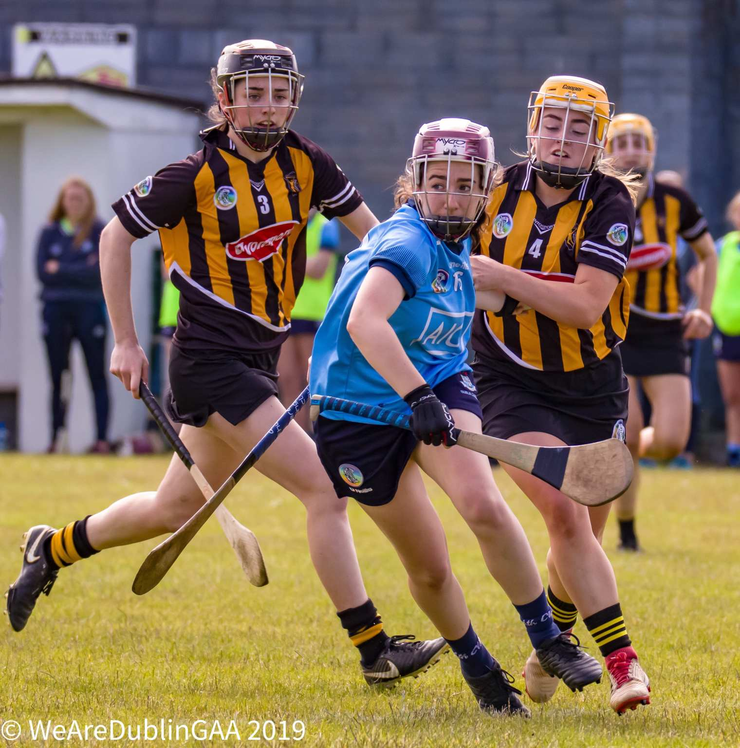A Dublin Camogie Players gets away from two Kilkenny players during their All Ireland championship game both the Dublin Senior And Intermediate teams lost their games.