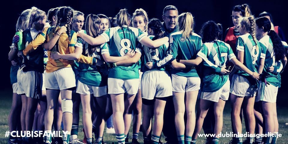 A ladies football team in a huddle before a game in the Dublin LGFA Club Competitions