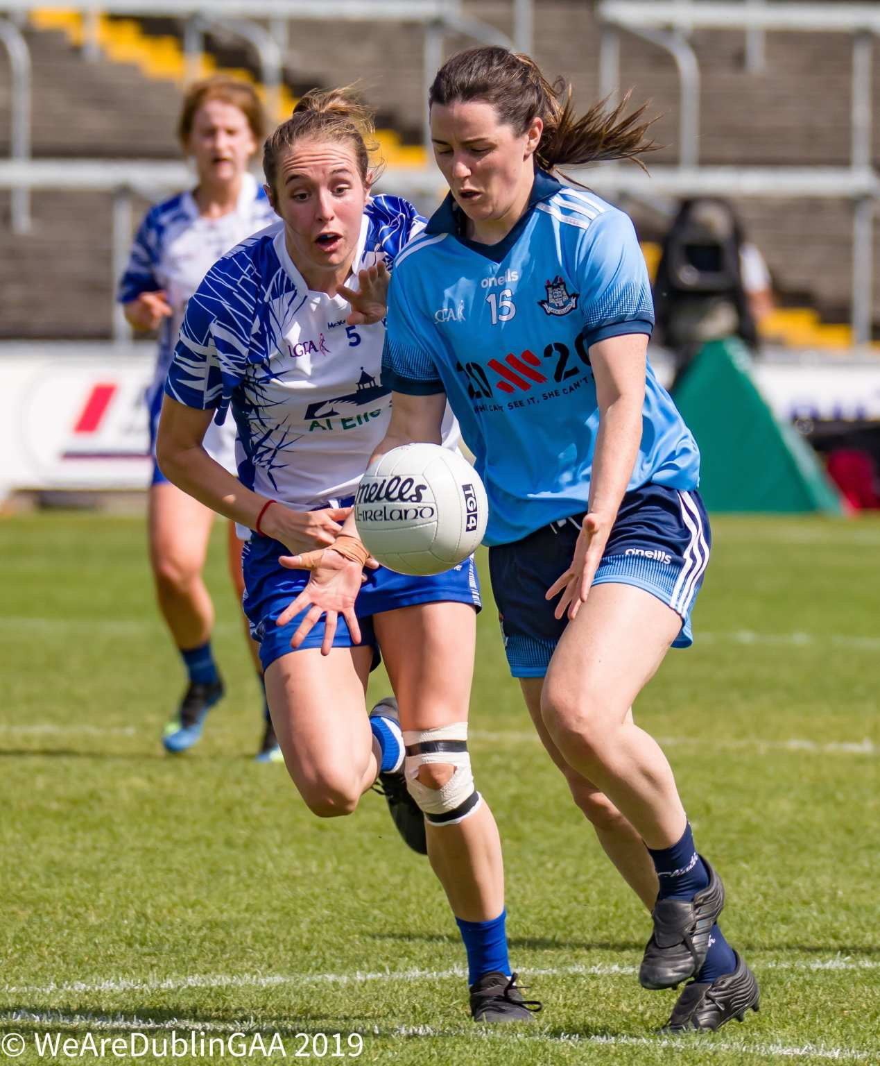 Lyndsey Davey breaks away with the ball from a Waterford player as Defending Champions Dublin comfortably Beat Waterford in the All Ireland Championship