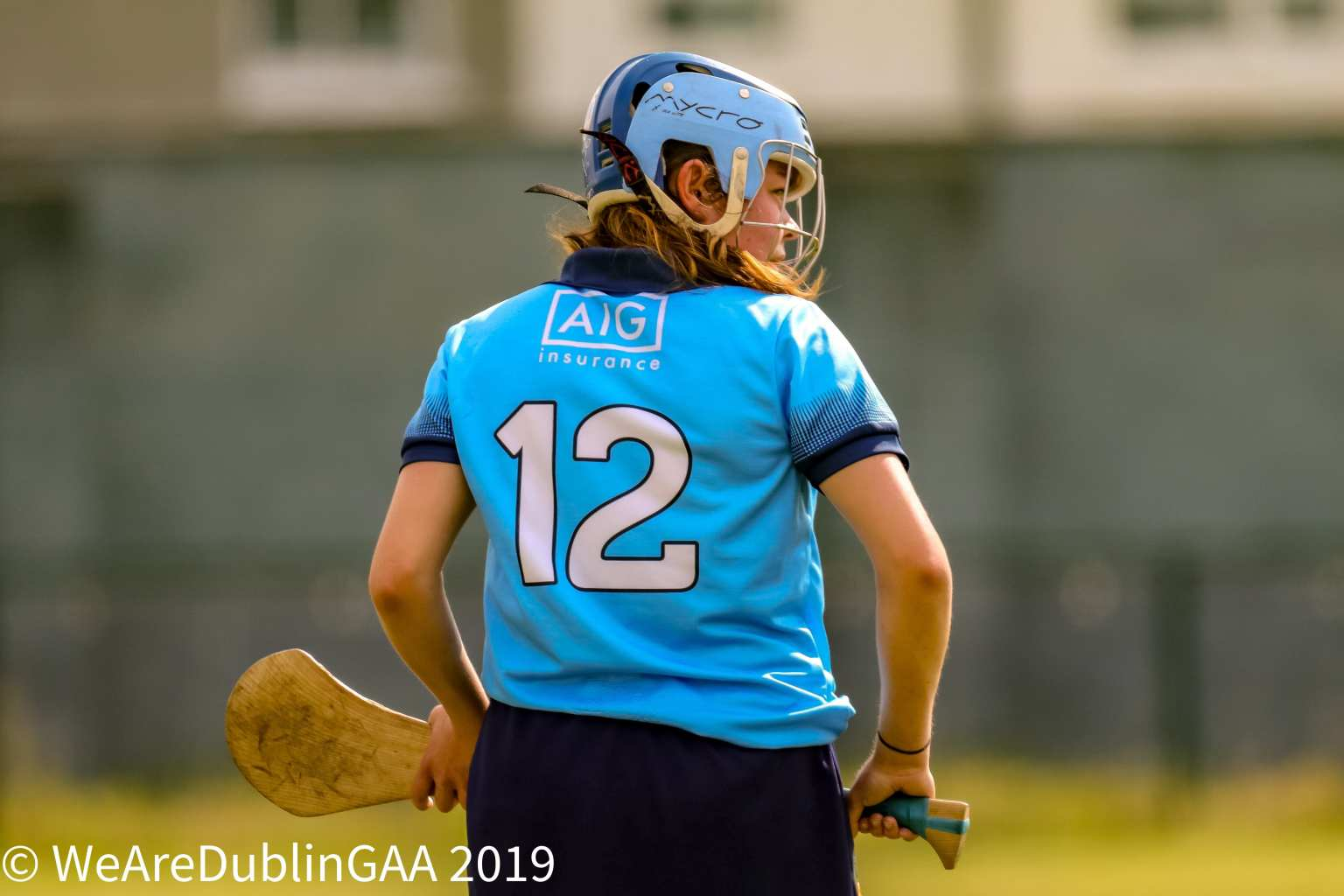 A player from the Dublin Intermediate Camogie Team looks sideways towards goal as she prepares to take a free