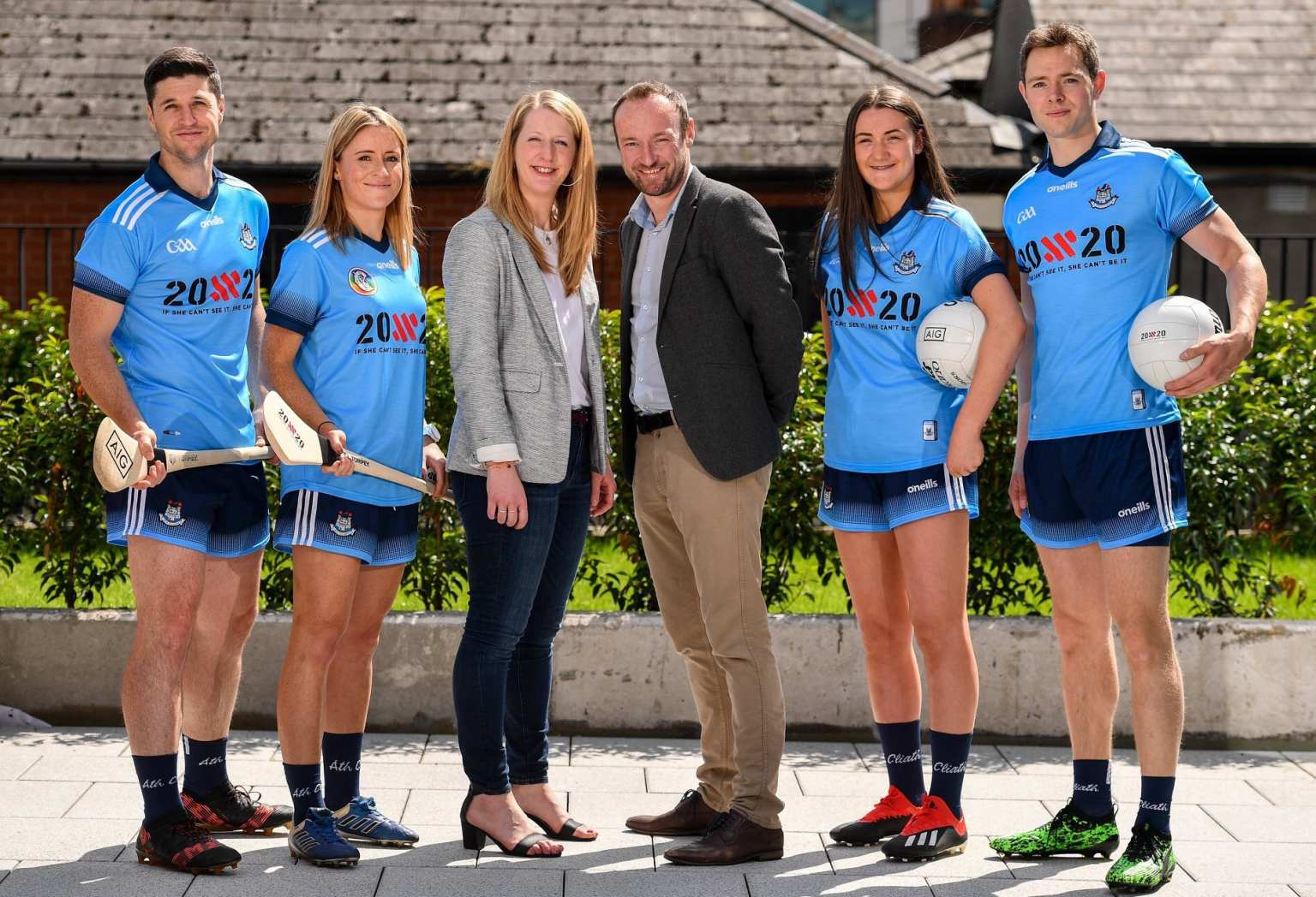 Dublin players from Ladies Football , Camogie, Football And Hurling pose in a Dublin GAA Jersey with the 20x20 Logo on the front at the announcement from sponsors AIG that the 20x20 movement will replace the AIG logo for an upcoming fixture in all four codes.