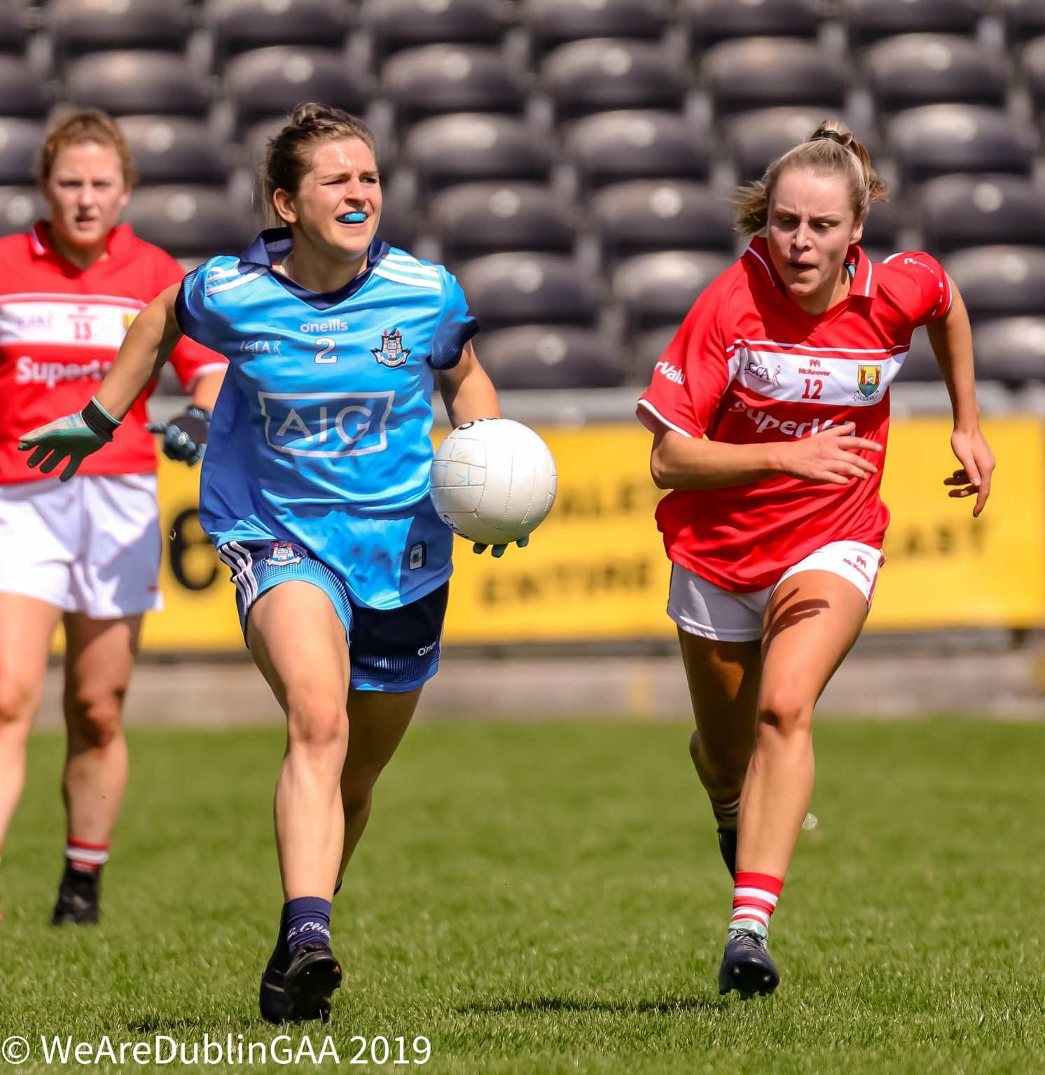 A Dublin ladies footballers breaks away from a Cork player, both sides meet this weekend in the TG4 Senior All Ireland Semi Final in Croke Park