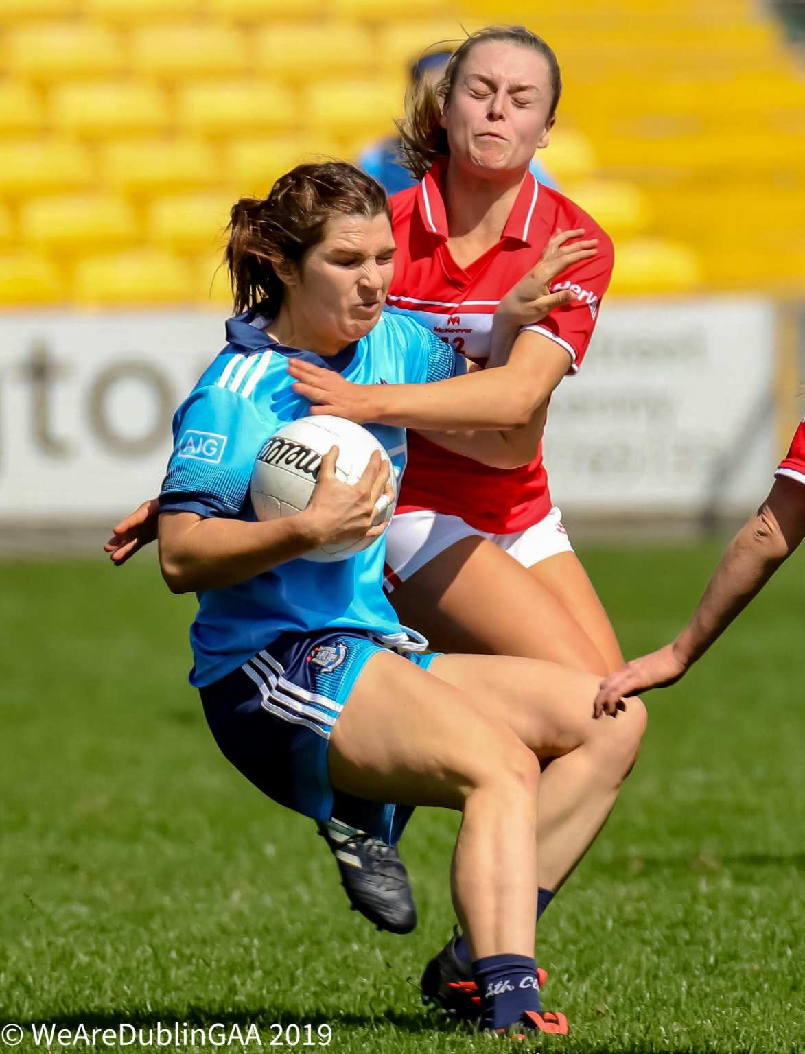 A Dublin and Cork ladies footballer battle for the ball both sides meet in the All Ireland semi final the semi final ticket information has been released