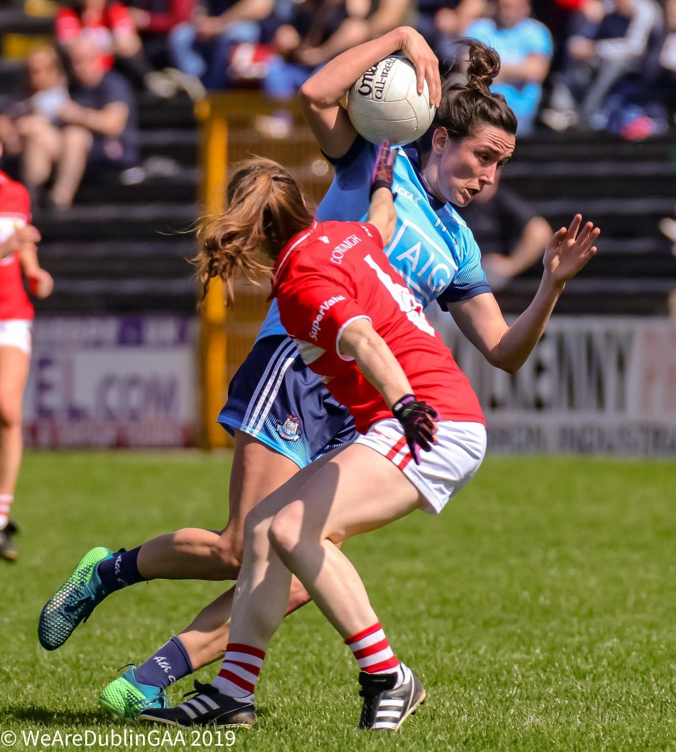 Dublin's Niamh McEvoy evades a tackle from a Cork player, both sides meet in the TG4 All Ireland Senior Ladies Football championship semi final this weekend.
