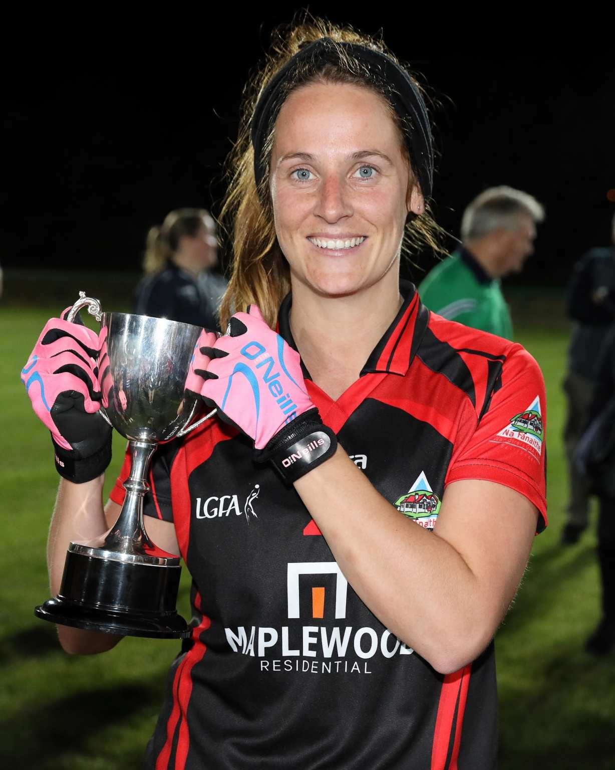 Wanderers Ladies Football Captain holding the Junior E championship trophy