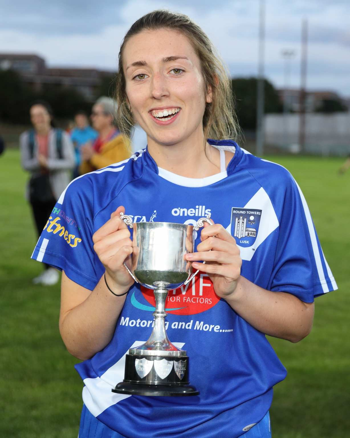 Round Towers Lusk captain holding the Dublin LGFA Junior F club championship trophy after her sides victory over Na Gaeil Oga in the final.