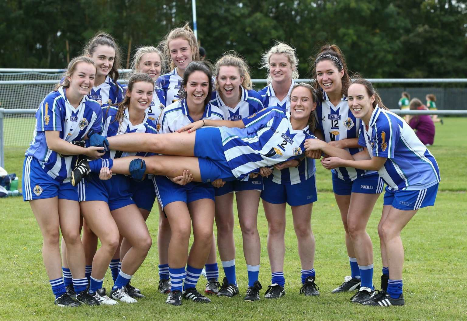 Group of players from Ballyboden St Endas holding one of the teams mates in the air, Ballyboden are among the clubs named to take part in the LGFA All Ireland Club 7s Tournament