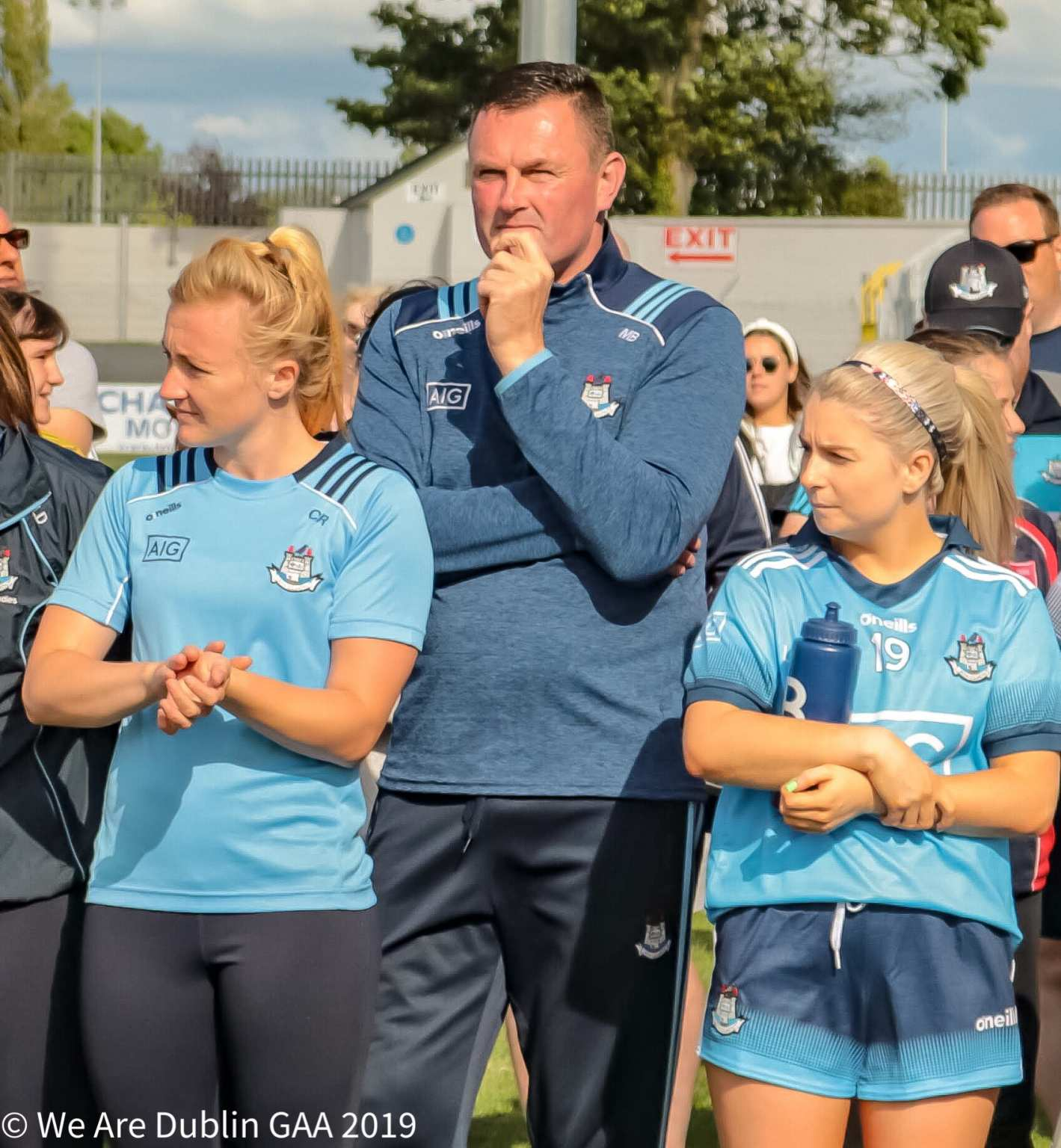 Dublin Senior Ladies Football manager Mick Bohan flanked by two players, Bohan says talk of Dublin's Dominance undermines the effort of the players.