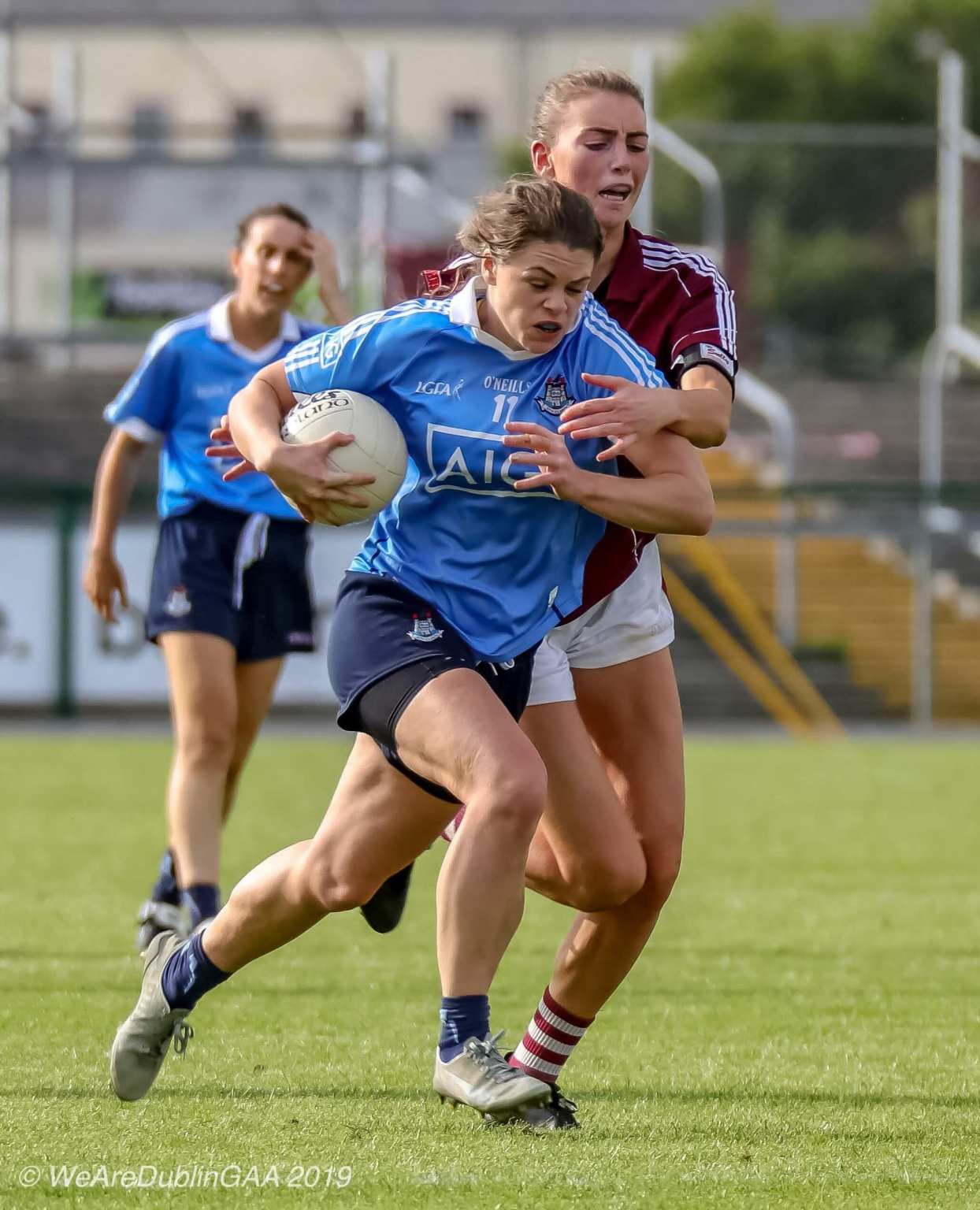 A Dublin Ladies Footballer is tackle by a Galway player both teams meet in the 2019 TG4 All Ireland Final