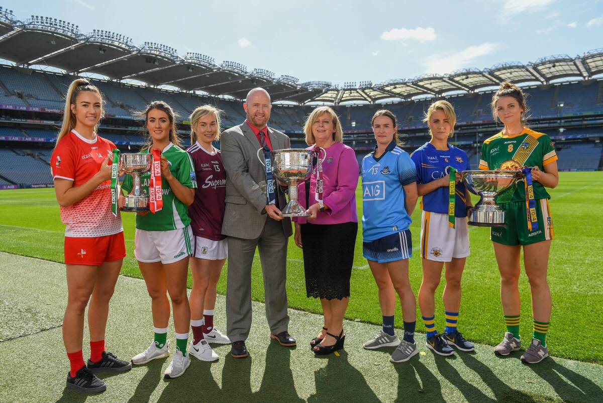 In attendance at a photocall ahead of the TG4 All-Ireland Junior, Intermediate and Senior Ladies Football Championship Finals on Sunday next, are from left, Louth captain Kate Flood, Fermanagh captain Joanne Doonan, Galway captain Tracey Leonard, Rónán Ó Coisdealbha, Head of Sport, TG4, Marie Hickey, President, Ladies Gaelic Football Association, Dublin captain Sinéad Aherne, Tipperary captain Samantha Lambert and Meath captain Máire O'Shaughnessy.