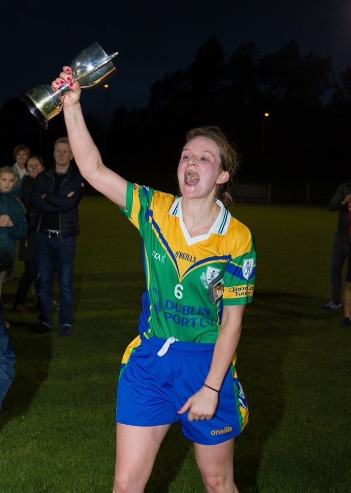 Clanna Gael Fontenoy Ladies Football Captain raises the Dublin LGFA Intermediate trophy into the air