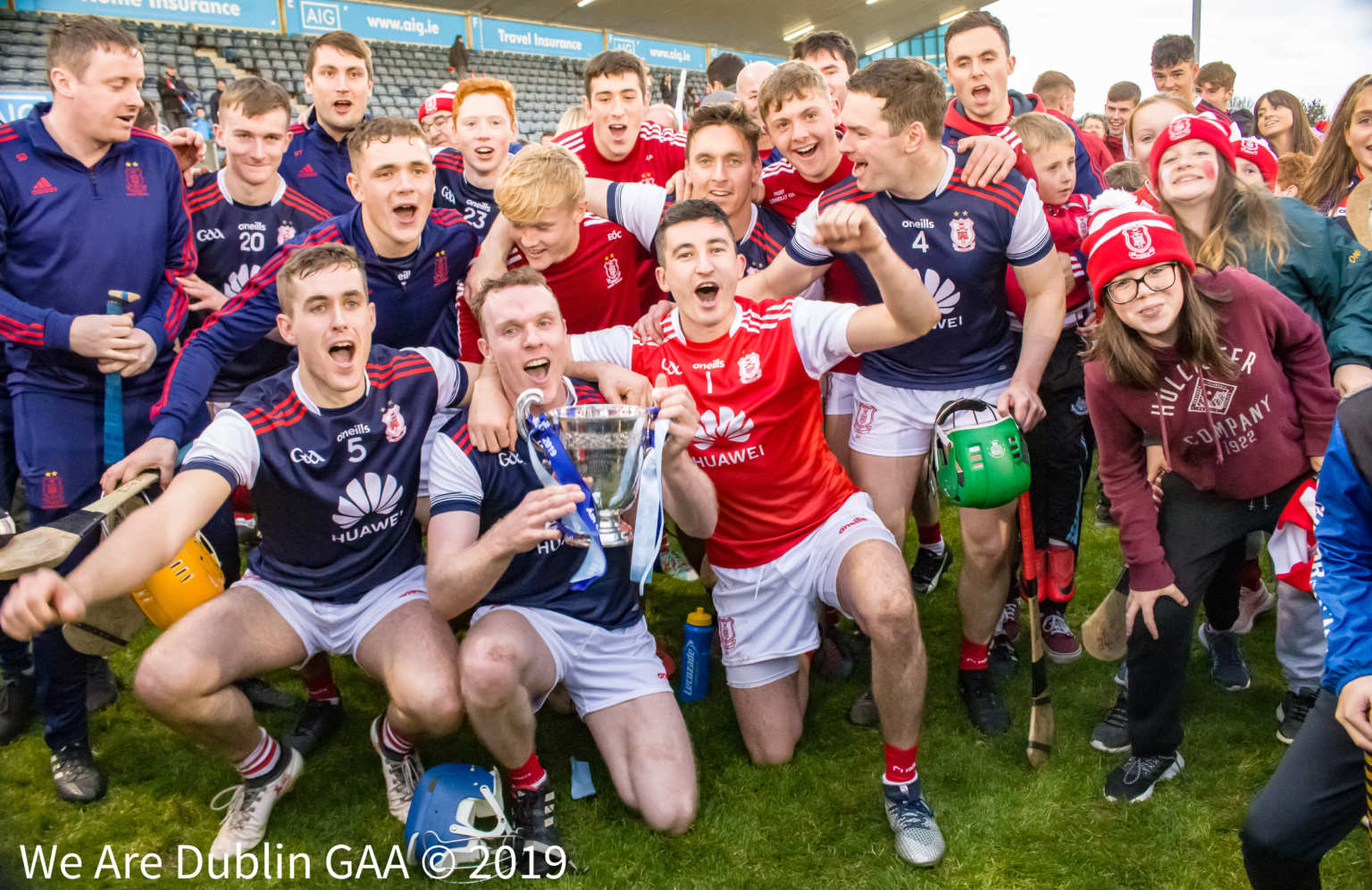 Cuala players celebrate on the pitch with the Dublin Senior hurling club title after beating St Brigids