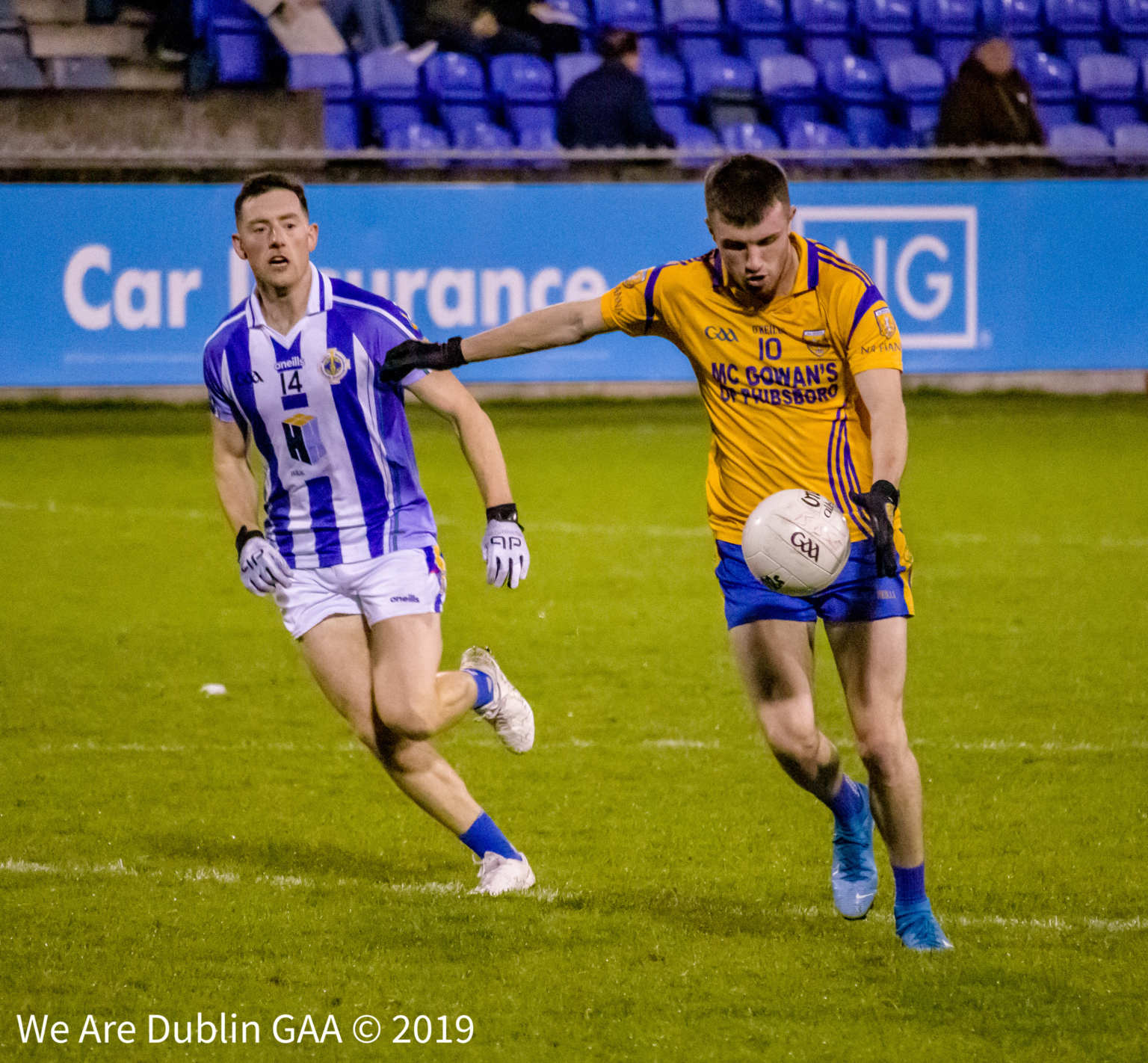 A Ballyboden St Endas Player watches on as a Na Fianna player takes a shot at goal in the Dublin SFC, Ballyboden won thanks to goals from Colm Basquel