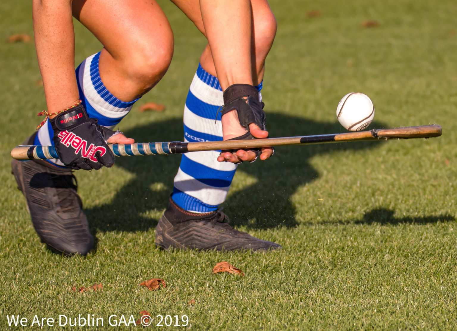 A Camogie players legs and hurl in hand lifting the ball off the ground to signify the announcement of the team of the 2019 Senior Camogie club championship