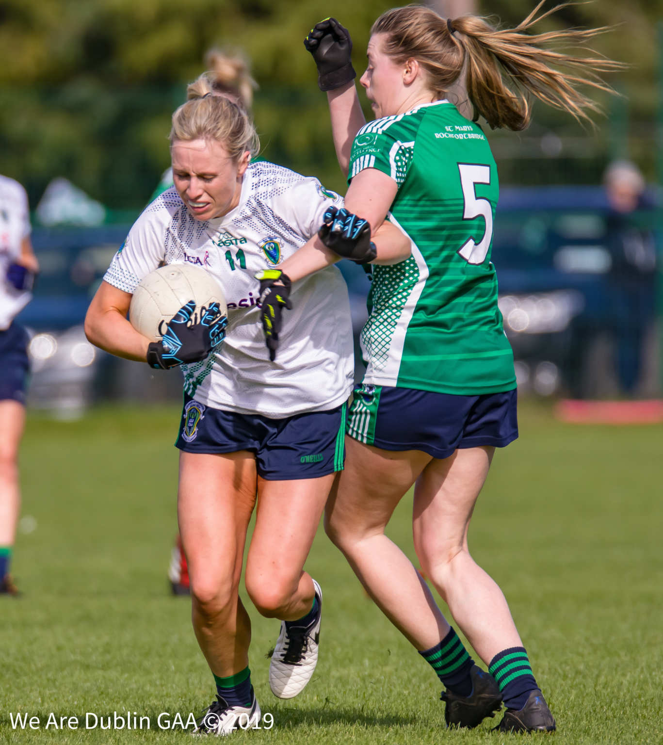 Foxrock Cabinteely number 11 Fiona Claffey tries to break the tackle of Lisa Cully from St Mary's Rochfortbridge during their Leinster Senior club championship game.