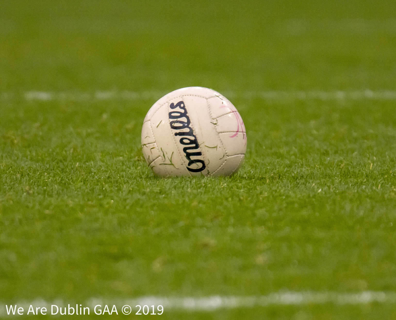 A Gaelic football on a grass pitch to signify the three proposed football rule changes to be voted on at Special Congress