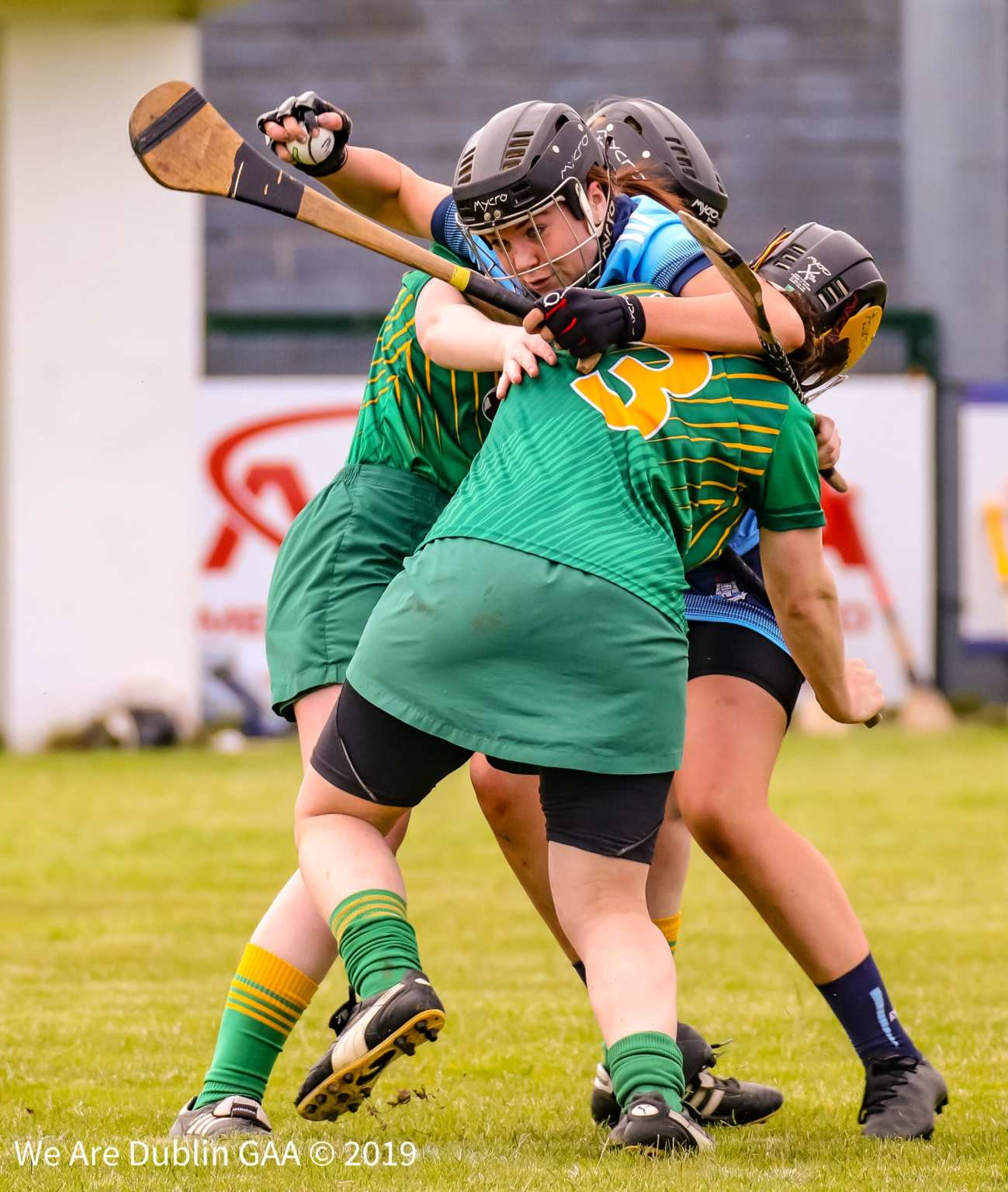 A Dublin Camogie Player is tackled by two meath players during a championship match, next season there will be trial rule changes to the game which may include the tackle rule