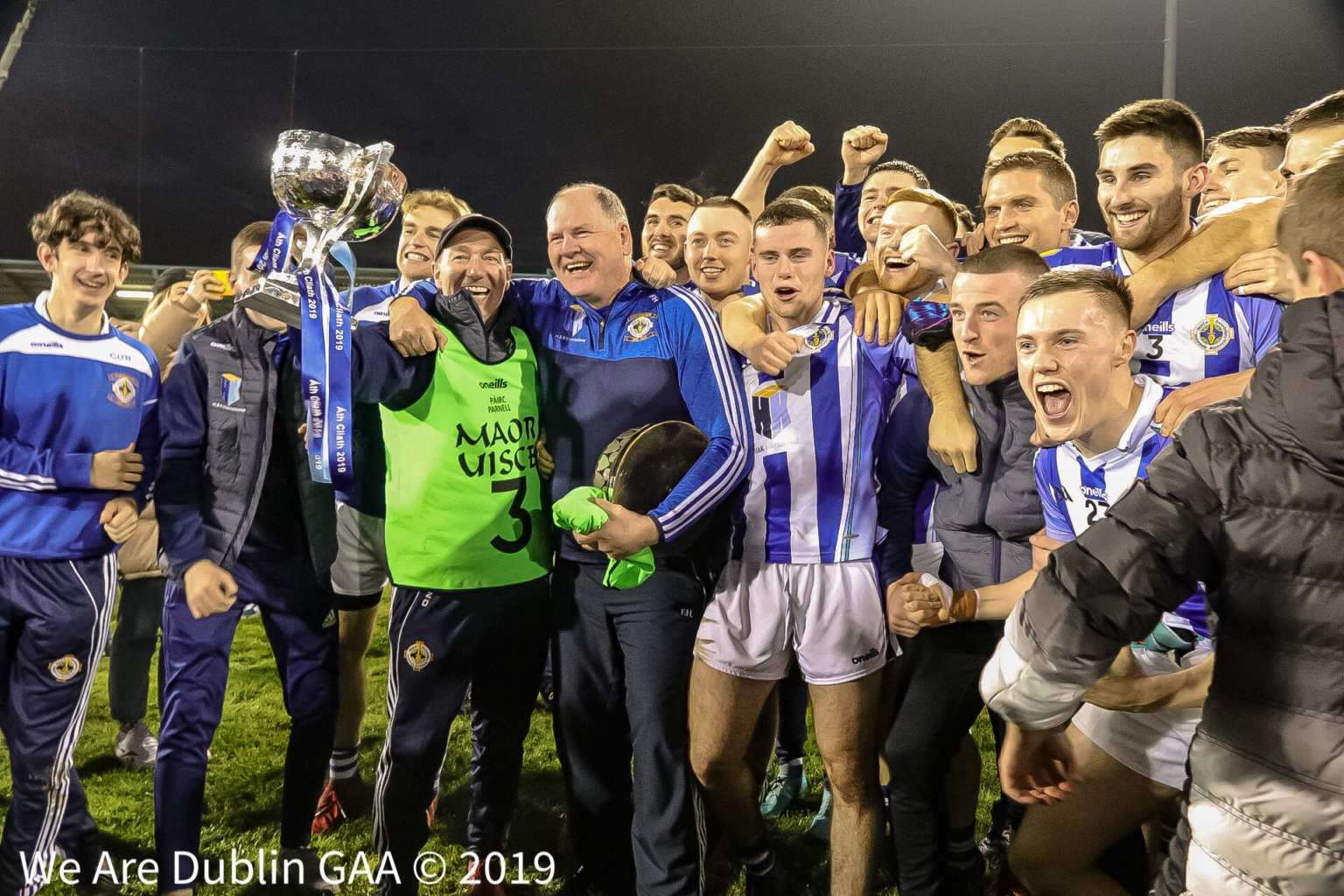 Ballyboden St Endas players and management celebrate on the pitch after winning the Senior County Final