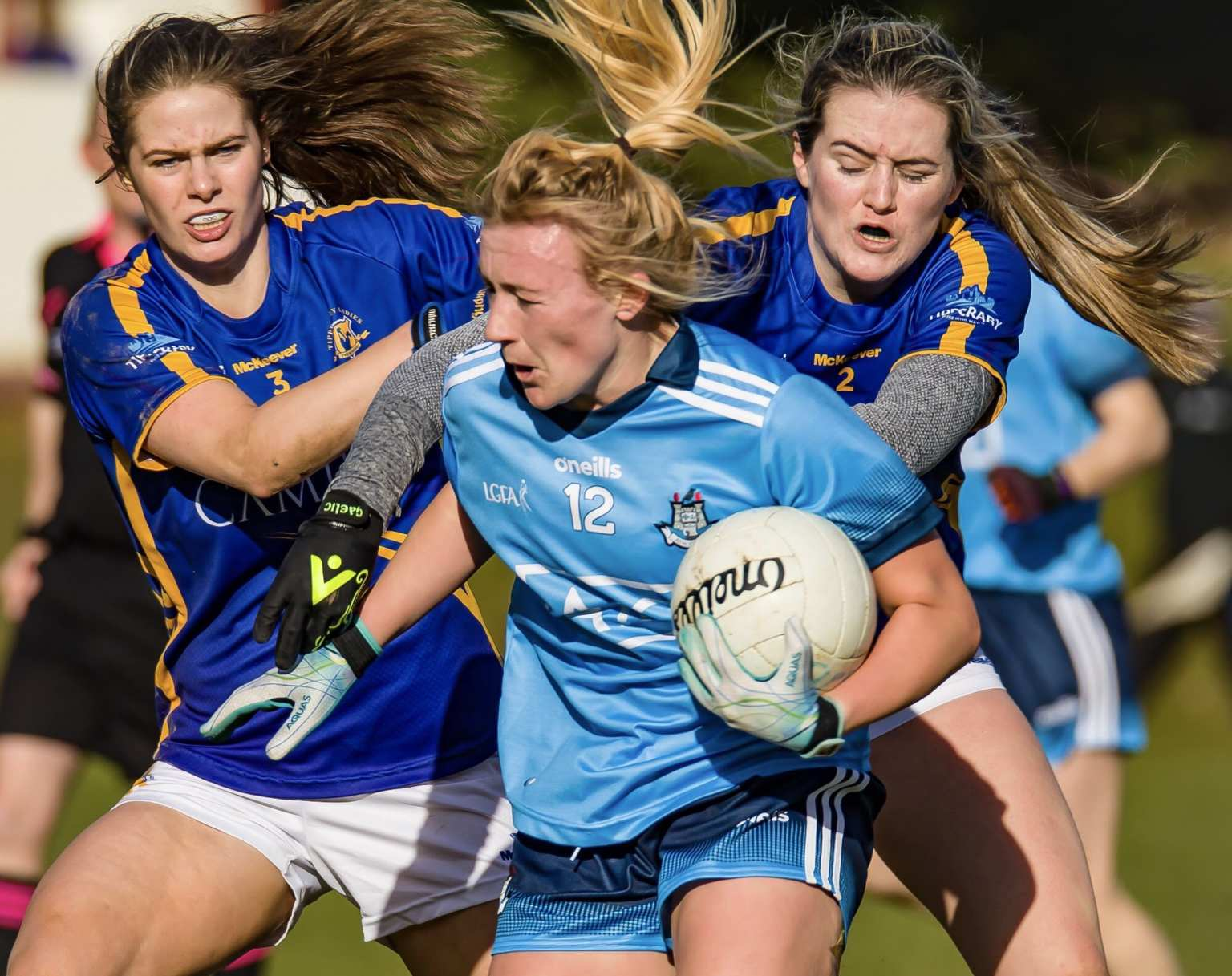 A Dublin ladies Footballer is tackled by two Tipperary players, both teams meet in the opening round of the 2020 Lidl Ladies NFL