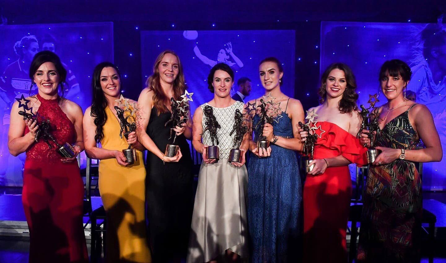 Seven Dublin Ladies footballers on stage with their All Star Awards at last years event, TG4 will once again broadcast Red Carpet Live from the 2019 All Stars Awards on their Facebook page.