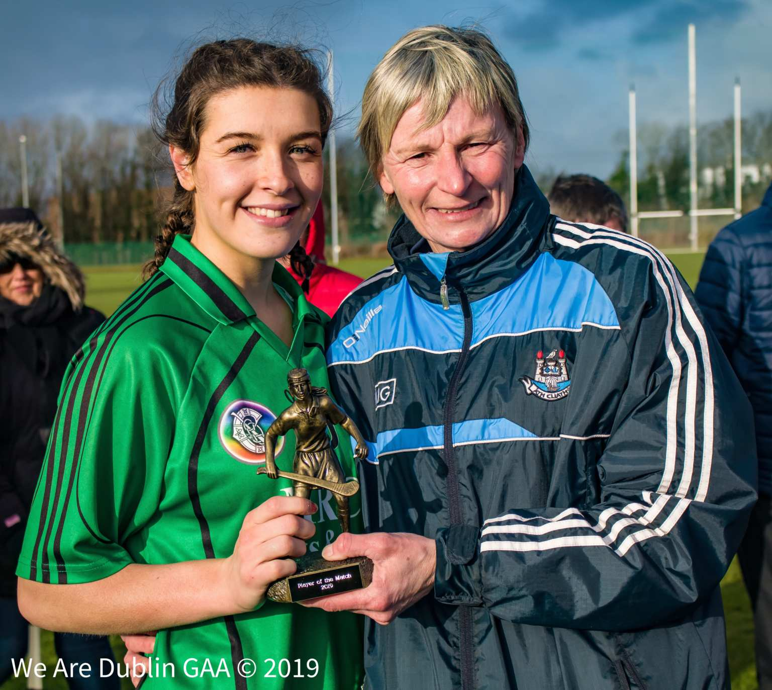 Player of the Match Laura Quinn from Lucan Sarsfields is presented with the trophy by Dublin Camogie Chairperson Jenny Byrne