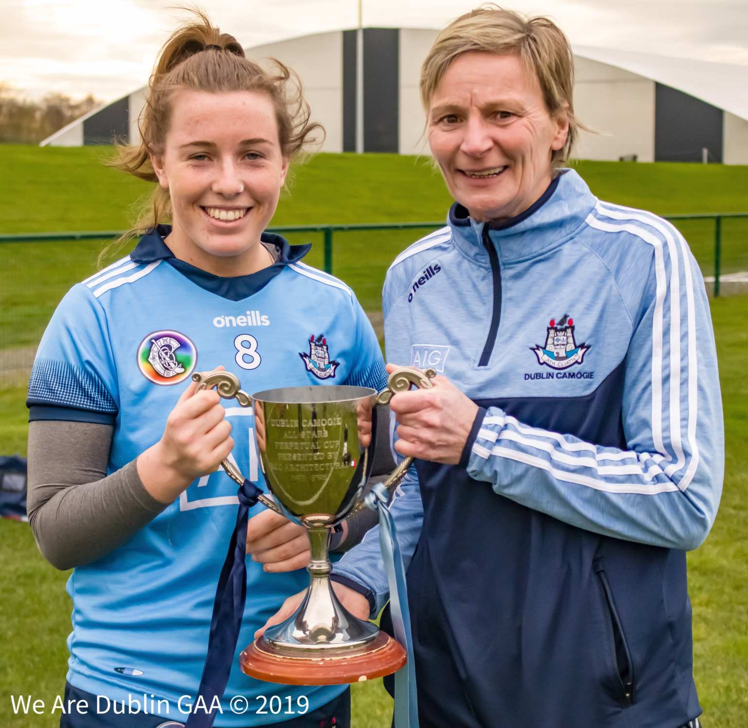 Dublin Captain Sinead Wylde is presented with the cup after her side won today's annual Camogie Dub Stars Game.