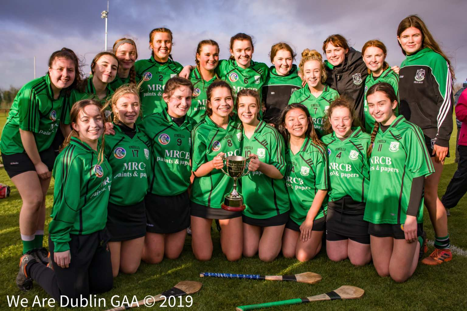 The Lucan Sarsfields squad with the Orla Quill Trophy after their victory in the Dublin Camogie Minor A club championship final.