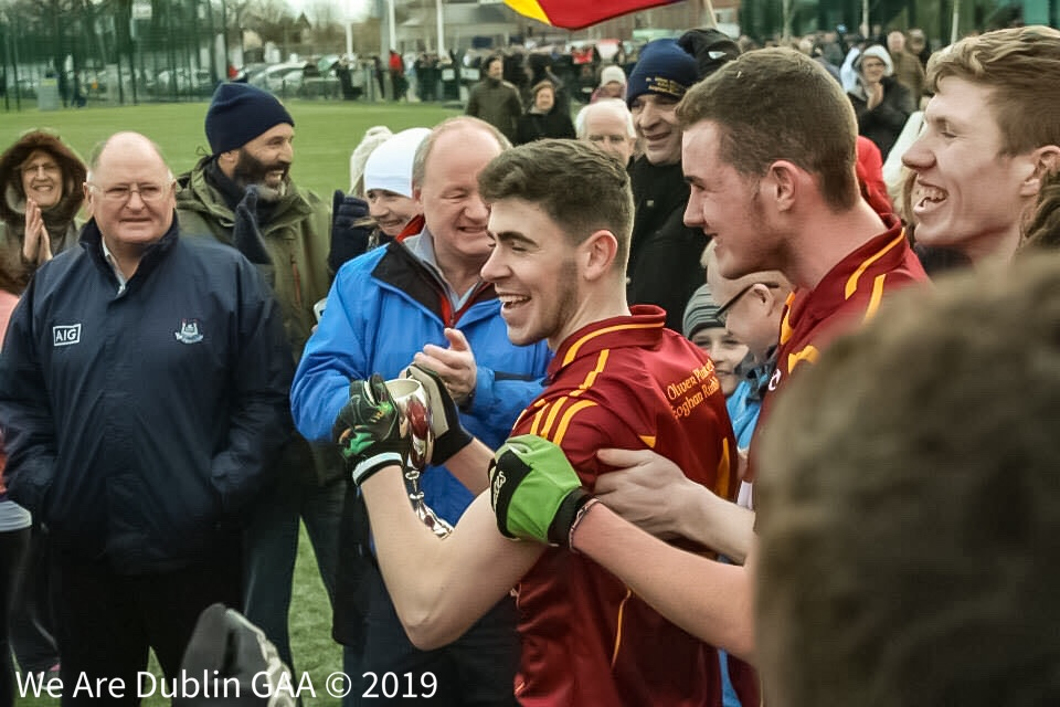 Conor Stone (centre) smiling and celebrating after a win with his club St Oliver Plunkett Eoghan Ruadh, Conor was forced to quit the game at just 20 years of age due to injury, that resulted in Conor suffering mental health issues including panic attacks.