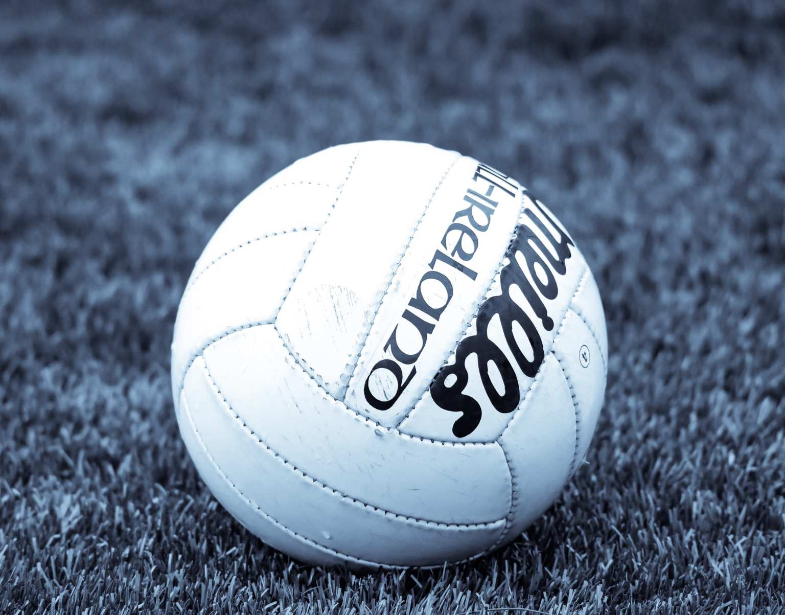 A Gaelic football on a pitch, new Gaelic football rules come into effect in 2020 including the advanced rule which will see forwards award a mark for a clean catch of the ball from a kick pass that travels over 20m without touching the ground