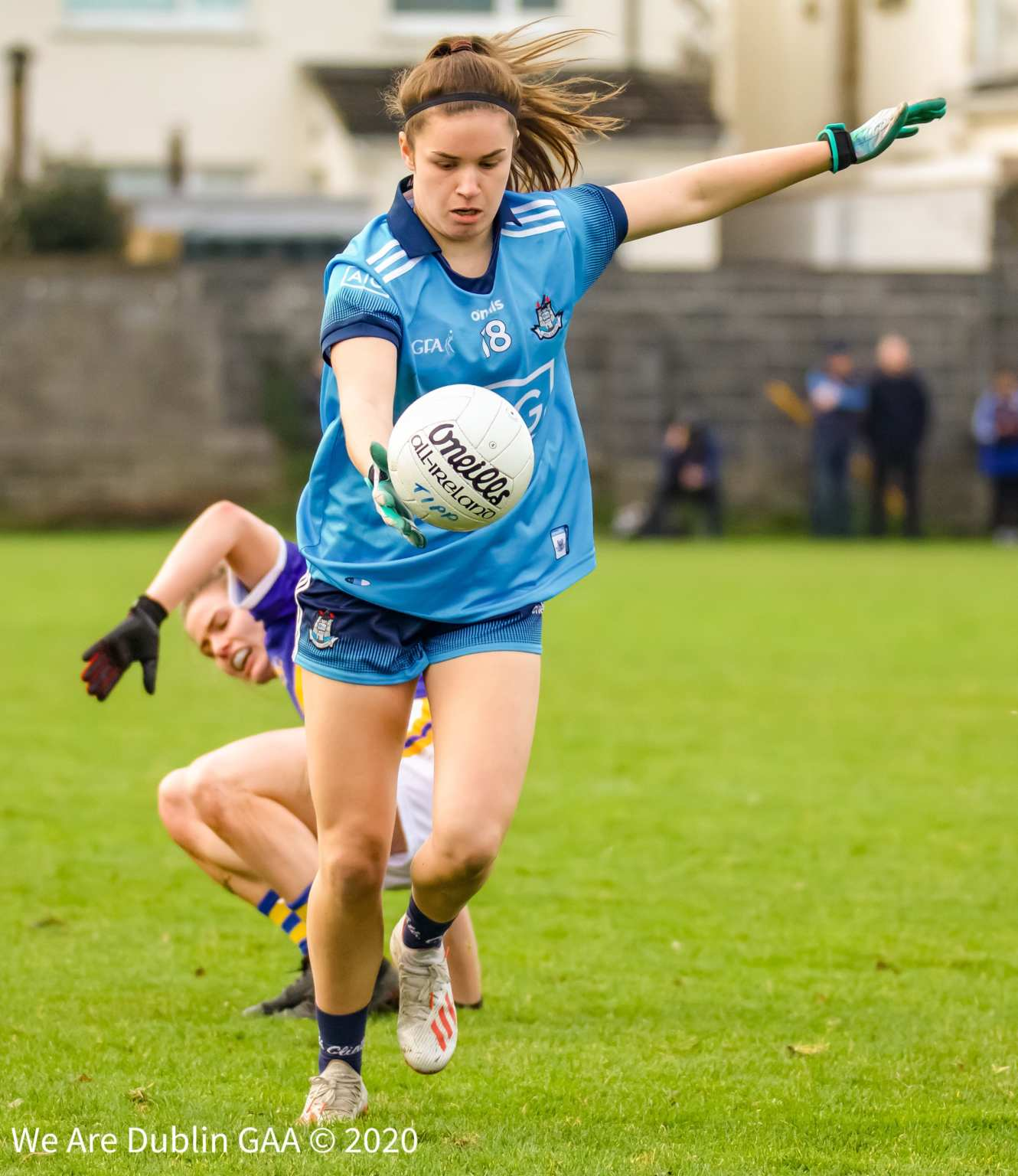 A Dublin ladies footballer just about to kick a shot at goal, Dublin get their 2020 leinster minor football championship underway this Friday evening against Meath.