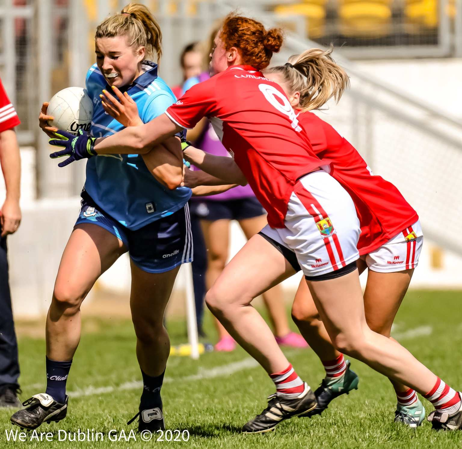 A Dublin player is tackled by two Cork players, both teams meet in A Lidl Ladies National Football League Round 3 game this weekend.