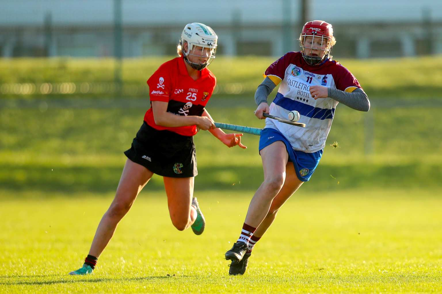 Two college Camogie players in action during the UPMC Ashbourne Cup weekend.