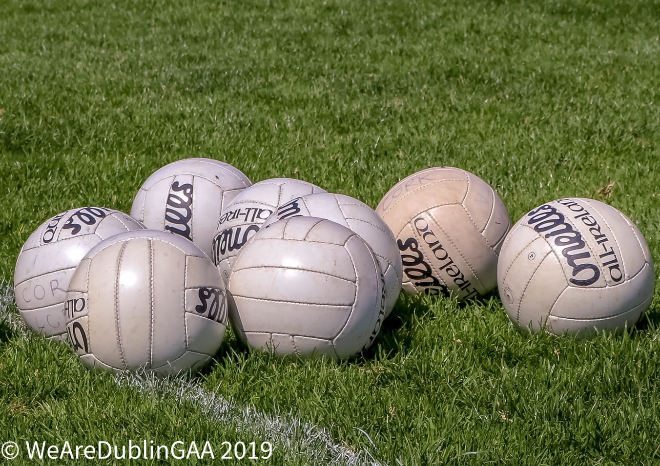 A group of Gaelic footballs on a pitch ahead of a training session, it's being reported that a plan to return to inter-county training at some point in the summer is being considered by the Department of Transport, Tourism and Sport.