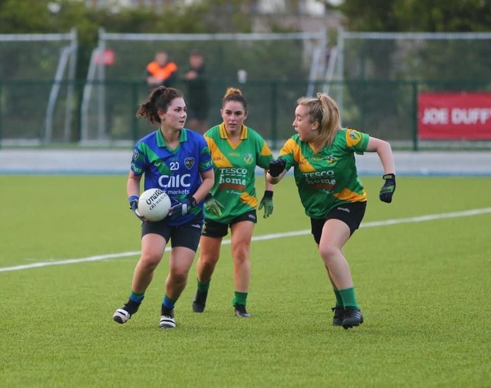 Three ladies footballers in action during a club championship game, a number of semi final pairings have now been decided after Wednesday's round 3 results.