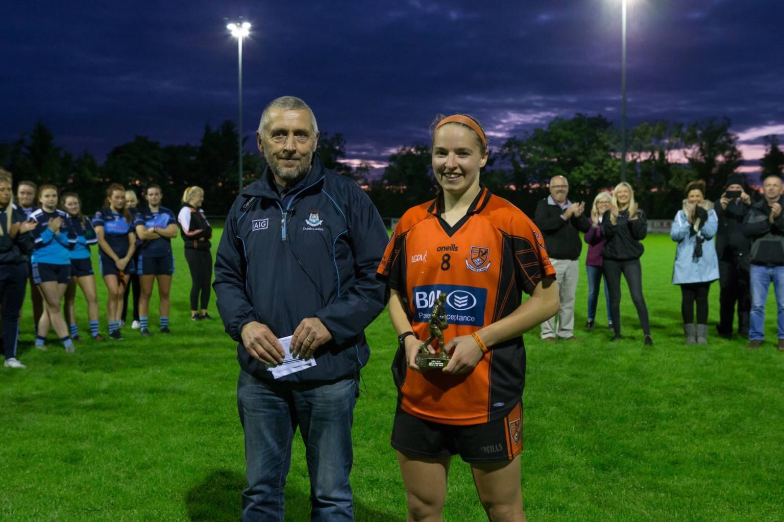 Orlagh Nolan presented with her Player of the Match award by Dublin LGFA chairman Joe Keane.