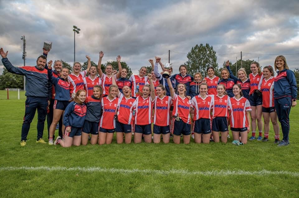 The Cuala squad and management celebrate after winning the Dublin Intermediate Ladies Football Championship title.