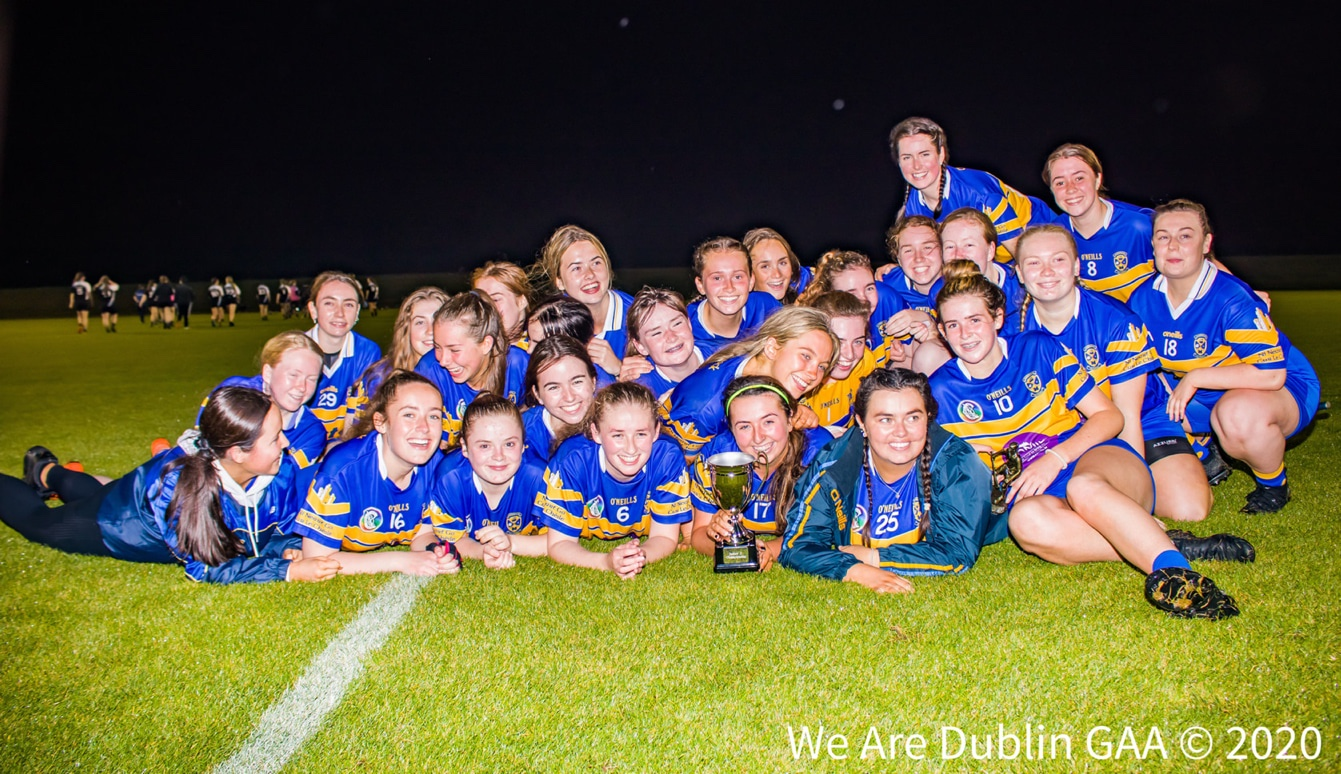 The Castleknock camogie squad celebrate with the cup after lifting the Junior 2 title.