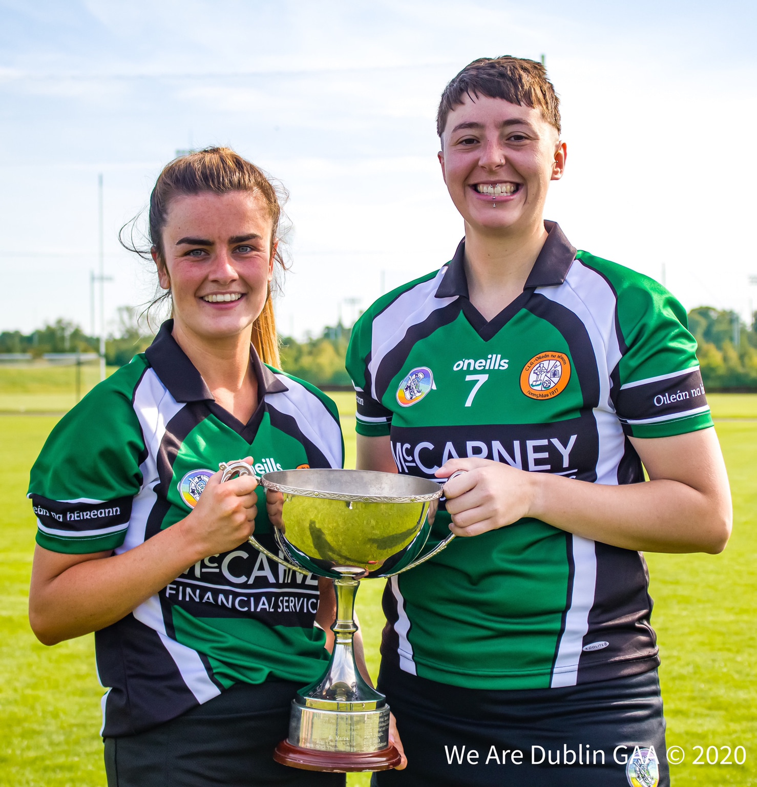 Erins Isle joint captains hold the Intermediate 1 title after defeating Naomh Peregrine in the club championship camogie final.