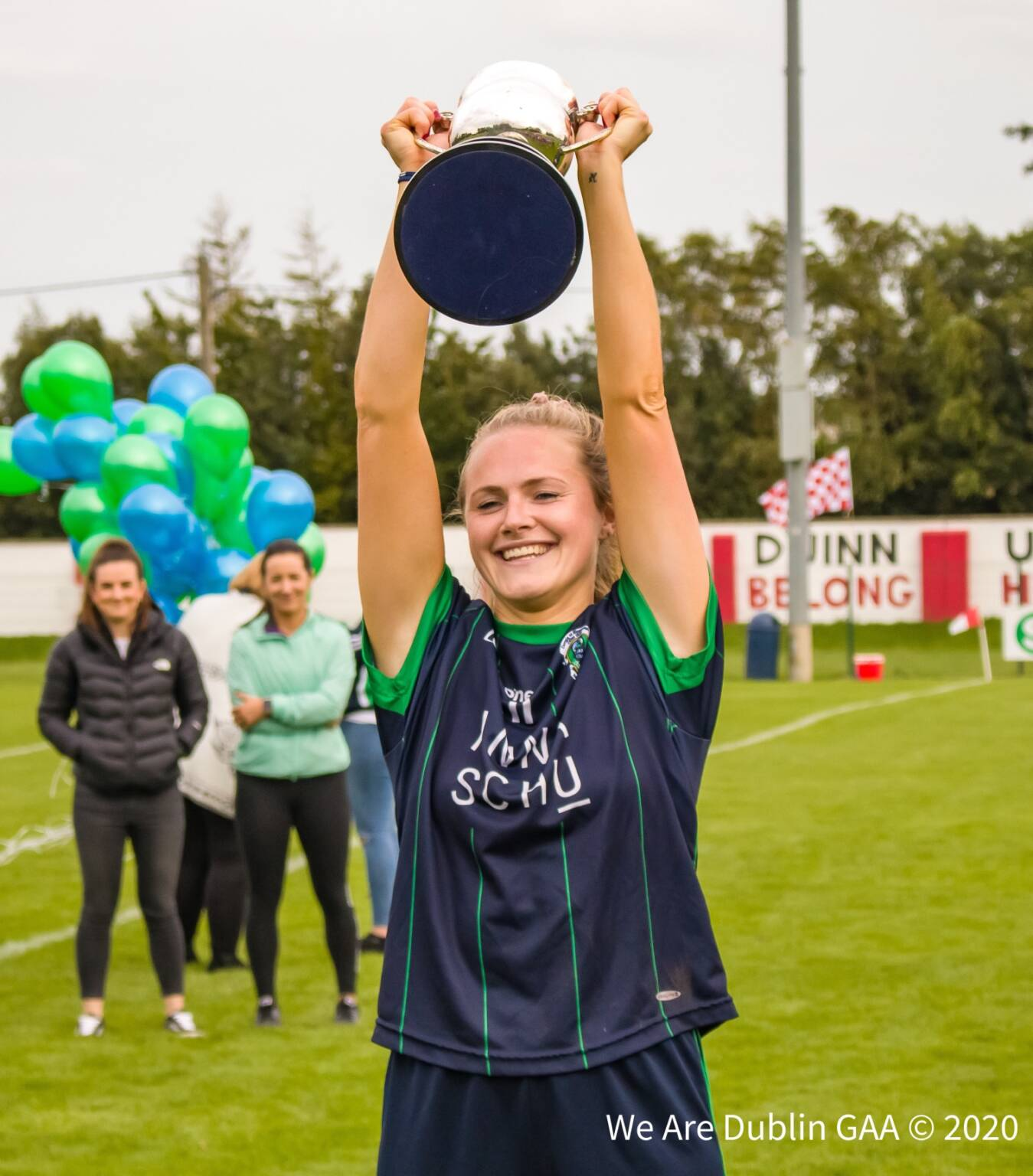 Foxrock Cabinteely captain Amy Connolly lifts the cup after her side win a sixth consecutive Dublin LGFA Senior club title.
