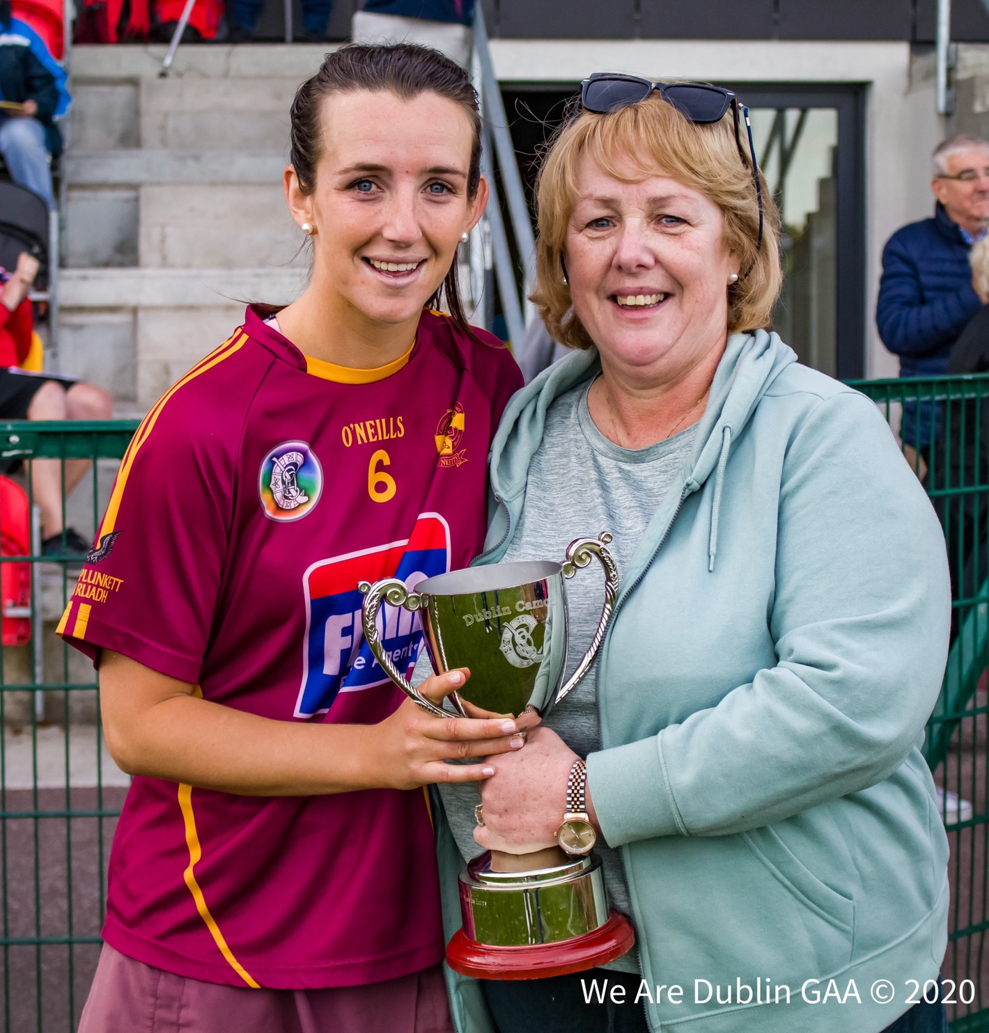 Plunketts captain Aisling Carolan holding the senior 2 club championship cup with her mother after St Oliver Plunkett Eoghan Ruadh defeated Cuala in the final