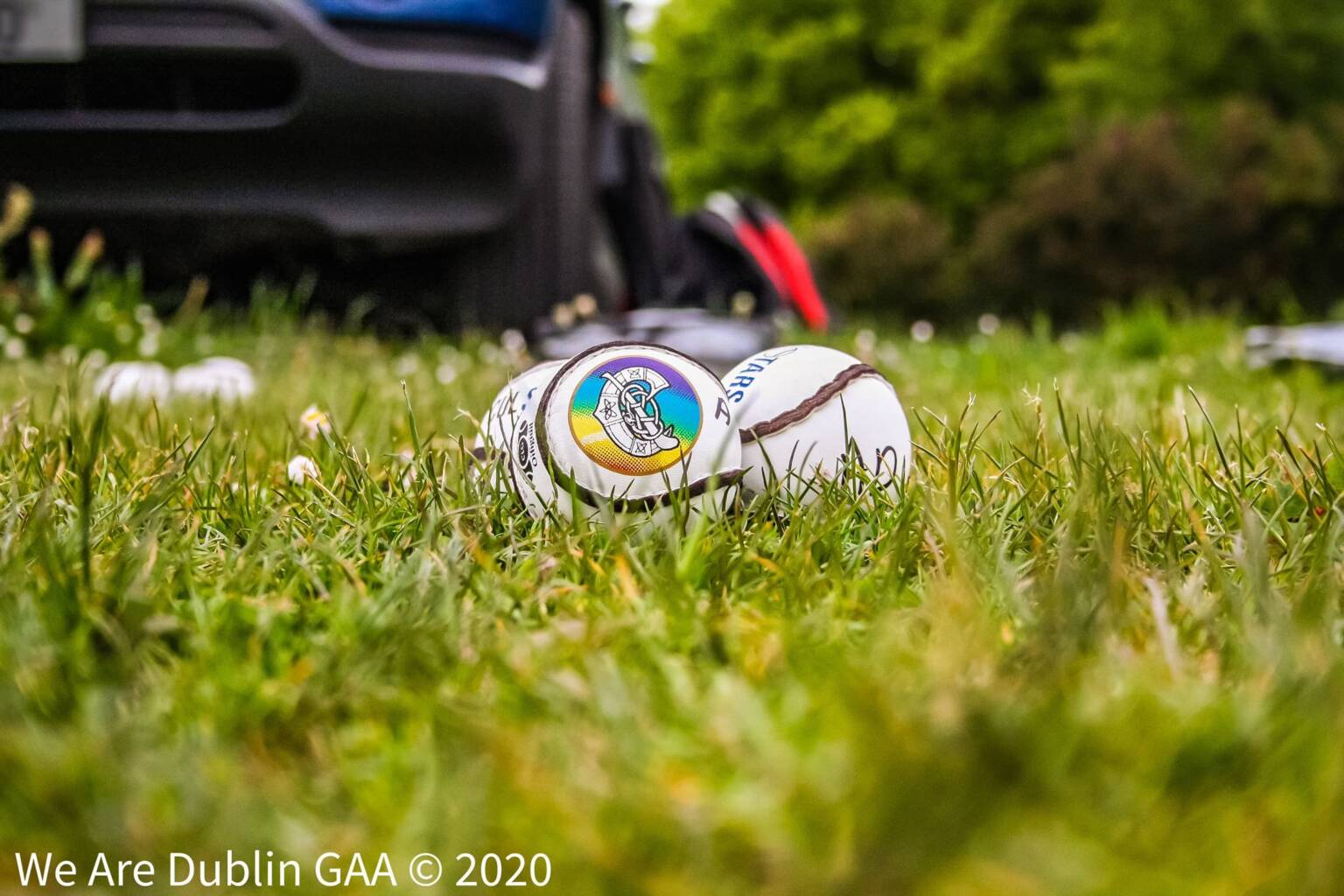 Three sliotars with the camogie logo, the Camogie Association have suspended all Camogie Club games until further notice
